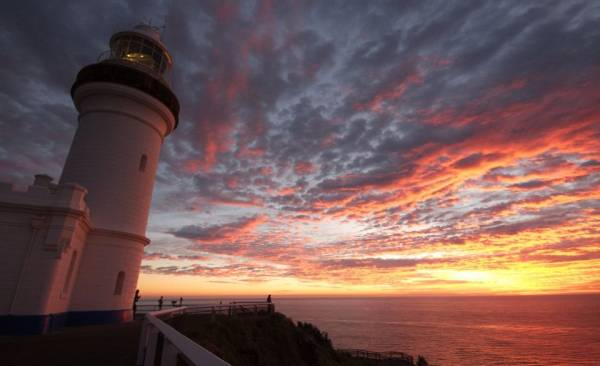 Catch the sunrise at Byron Bay Lighthouse.